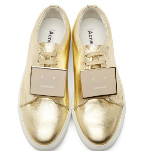 Acne Studios: Gold Leather Adriana Sneakers | SSENSE