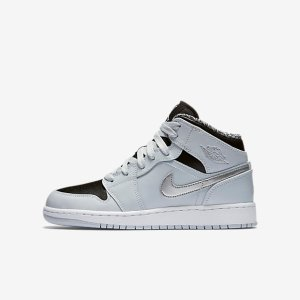 Air Jordan 1 Mid (3.5y-7y) Big Kids' Shoe.