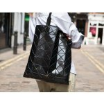with Bao Bao Issey Miyake Purchase @ Saks Fifth Avenue