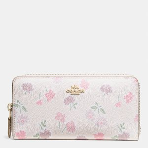ACCORDION zip wallet in daisy field print coated canvas by Coach | Spring - Free Shipping. On Everything