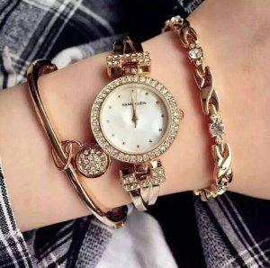 Lowest price! $49.99 ( reg $150 ) Anne Klein Women's AK/1868GBST Swarovski Crystal-Accented Gold-Tone Bangle Watch and Bracelet Set
