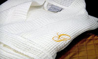 Up to 83% Off One or Two Luxor Linens Egyptian-Cotton Spa Robes in Black, Red, or Gold