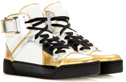 $841 + Free Shipping GUCCI Metallic leather high-top sneakers
