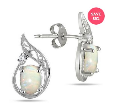 $381.00 CARAT OVAL OPAL AND DIAMOND EARRINGS IN .925 STERLING SILVER