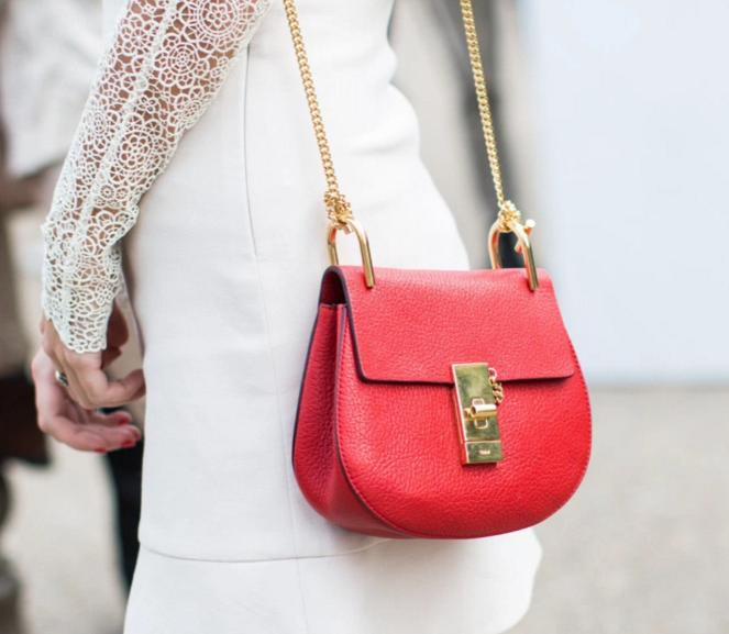 Up To $900 Gift Card with Select Red Handbags Purchase @ Saks Fifth Avenue