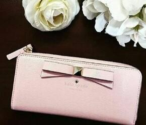 Up to 75% Off + From $39 Select Wallets on sale @ kate spade