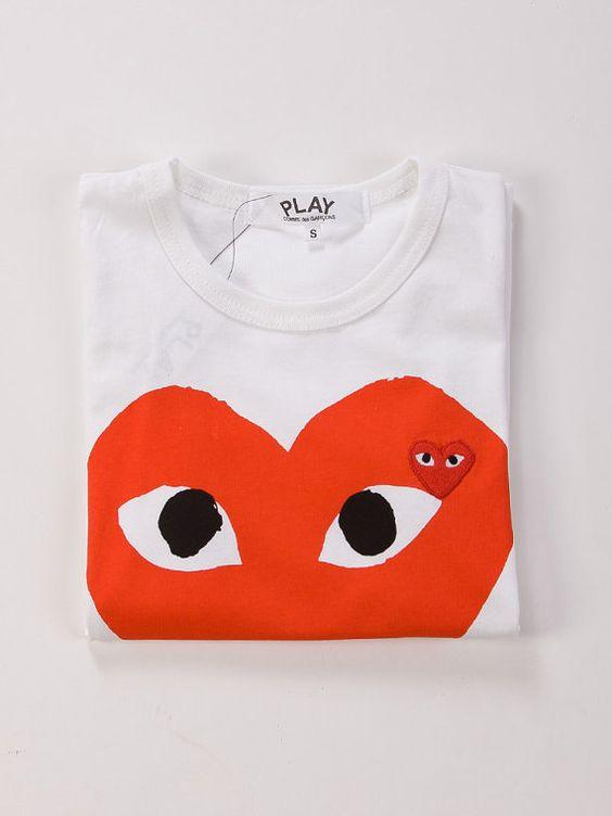 15% Off Comme des Garcons Play Men's Apparel and more @ Saks Fifth Avenue