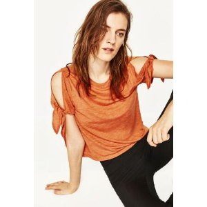 T - SHIRT WITH CUT OUT SLEEVES AND KNOTS