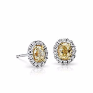 Yellow Oval Diamond Halo Earrings in 18k White and Yellow Gold (7/8 ct. tw.) | Blue Nile