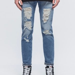 Palm Angels Regular Fit Ripped Light Wash Jeans | HBX.