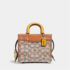 CoachWomen's Signature Jacquard With Bouquet Embroidery Rogue Bag 17 - Brown