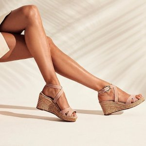 Espadrilles and wedges + Everything up to 70% offThe Stuart Weitzman Outlet Plan for your summer getaway