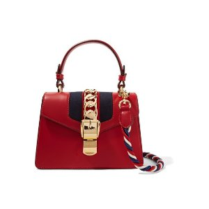 30321ea5ace595 Gucci Soho Disco textured-leather shoulder bag. GucciSylvie mini  chain-trimmed leather and canvas shoulder bag