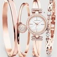 Extended: Lowest priceAnne Klein Women's AK/2238RGST Swarovski Crystal-Accented Rose Gold-Tone Bangle Watch and Bracelet Set