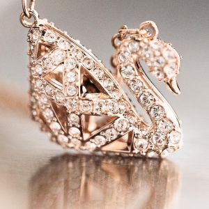 Free ToteWith any Purchase $175+ Iconic swan @Swarovski