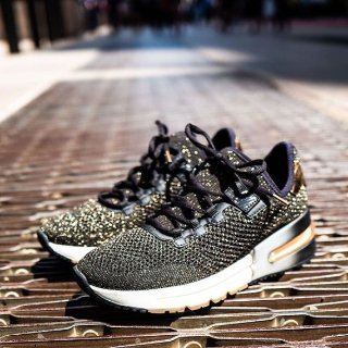 Up to Extra 50% OffNM Last Call Select Sneakers Sale