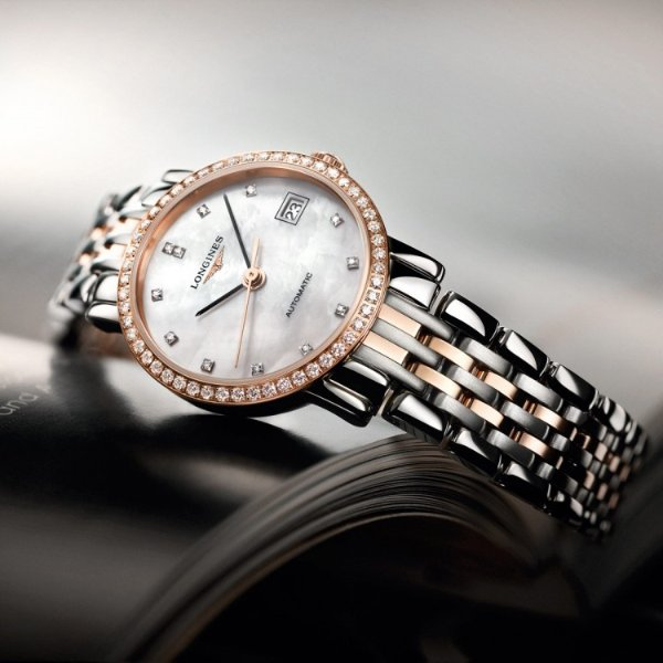 Eleganrt Collection 镶钻珍珠母贝机械奢华女表
