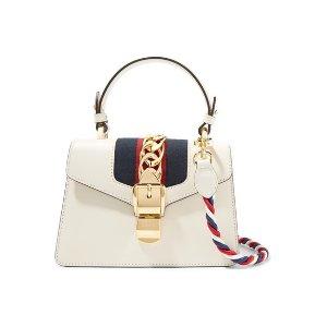 f31f510391283b Gucci Soho Disco textured-leather shoulder bag. GucciSylvie mini  chain-embellished leather shoulder bag