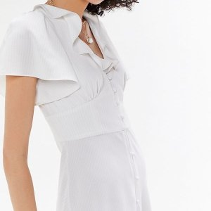 $19.99(Org.$79.00) + Free ShippingUrban Outfitters Button-Front Ruffle Midi Dress