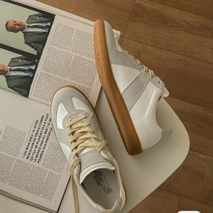 Maison MargielaReplica leather and suede sneakers