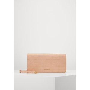 Coccinelle粉色压纹单肩包