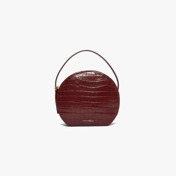 酒红色手提包