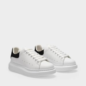 Alexander McQueen经典速度冲黑尾小白鞋