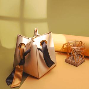 全站美包不过百 独家8折 全球包邮Unitude 小众高级感的平价打开方式,$79收全站热卖法式丝带水桶包