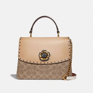 8de2da19292f Coach Parker Top Handle With Tea Rose Stones · CoachParker Top Handle in  Signature Canvas With Rivets