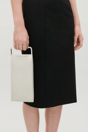 METAL-HANDLE LEATHER CLUTCH  - Biscuit - Bags - COS