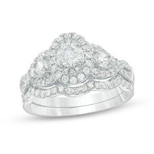 1-1/6 CT. T.W. Diamond Three Stone Oval Frame Twist Bridal Set in 14K White Gold|Zales