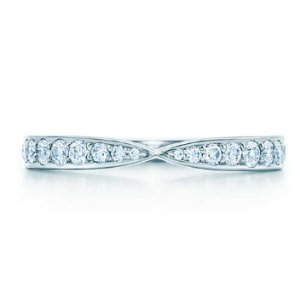 Tiffany Harmony® ring in platinum with bead-set diamonds.   Tiffany & Co.