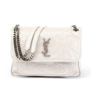 e6b856f17b Saint LaurentNiki Medium Monogram YSL Shiny Waxy Quilted Shoulder Bag.  $1850.00 $2250.00. Saint Laurent Niki ...