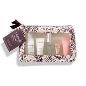CaudalieFavorites Set's cult skincare products in a pretty travel bag